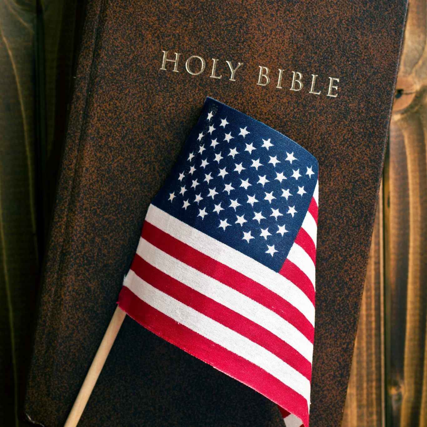 bigstock-holy-bible-with-american-flag--52067398